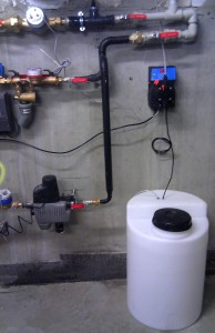 Dozowanie inhibitora korozji do systemu grzewczego - instalacja w galerii handlowej